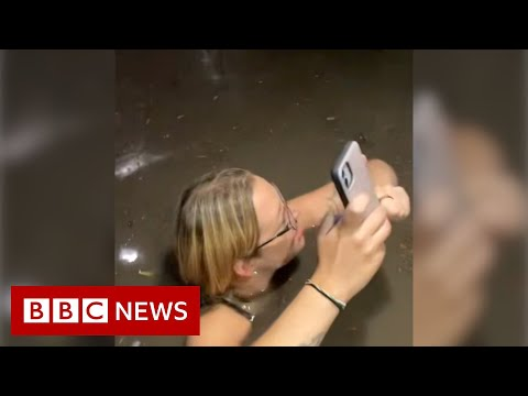 Friends trapped in flooding elevator during US storm – BBC News